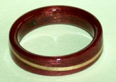 purple heart wood ring with a clear juniper spiraled band