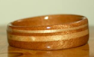 Jordan's cherry wood ring with a band of ash and a band of maple