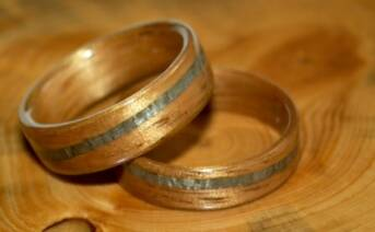 Golden toned koa wood rings with spiraled greyed maple bands
