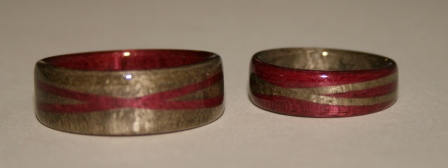 Wooden rings, greyed maple and purple heart wood with crossed spiraled bands