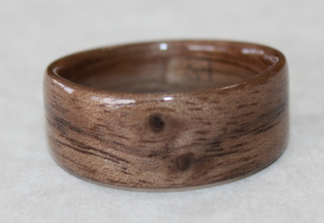 mid toned black walnut ring with featured knots