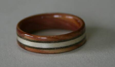 Juniper heartwood ring with three inlaid bands