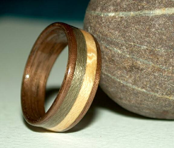 Walnut wood ring with grayed maple and birds eye maple inlays