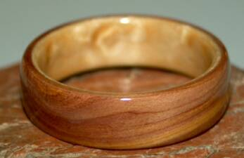 Juniper heart wood ring with birds eye maple liner from TOUCH WOOD RINGS