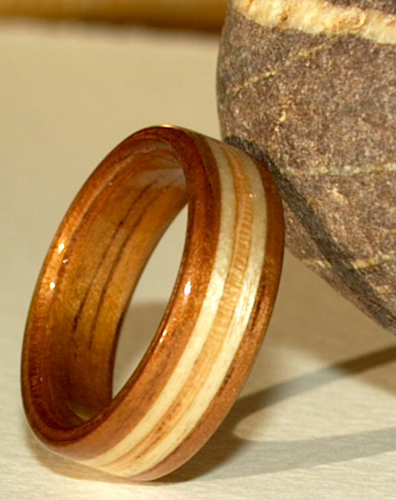 click for another view of this koa wood engagement ring with birch zebra wood bands - Koa Wood Wedding Rings