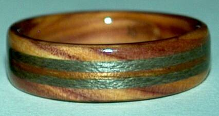 juniper heartwood ring with greyed maple and koa bands