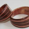 Primary wood is Black Walnut, the interior is JUNIPER HEARTWOOD as are the three inlaid bands.