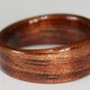 Gently tapered KOA wood ring with golden streaks