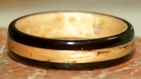 black wood ring lined with birds eye maple