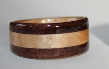 Black Walnut Ring with curly maple inlay and liner