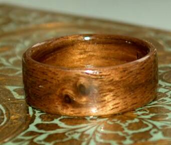 Natural Yin Yang markings on a black walnut wood ring  1
